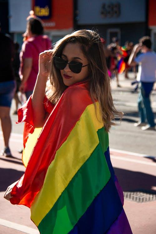 Woman Holding Rainbow Coloured Flag