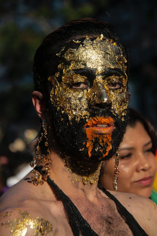 Woman Wearing Gold Mask