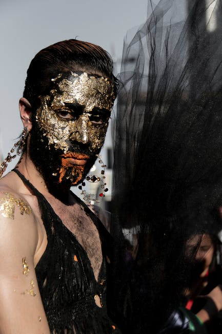 Woman with face mask wearing black halter top close up photography