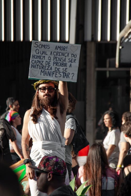 Man Raising White Signage