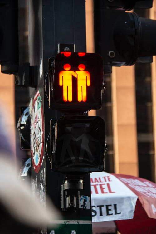 Black Traffic Light Displaying Stop