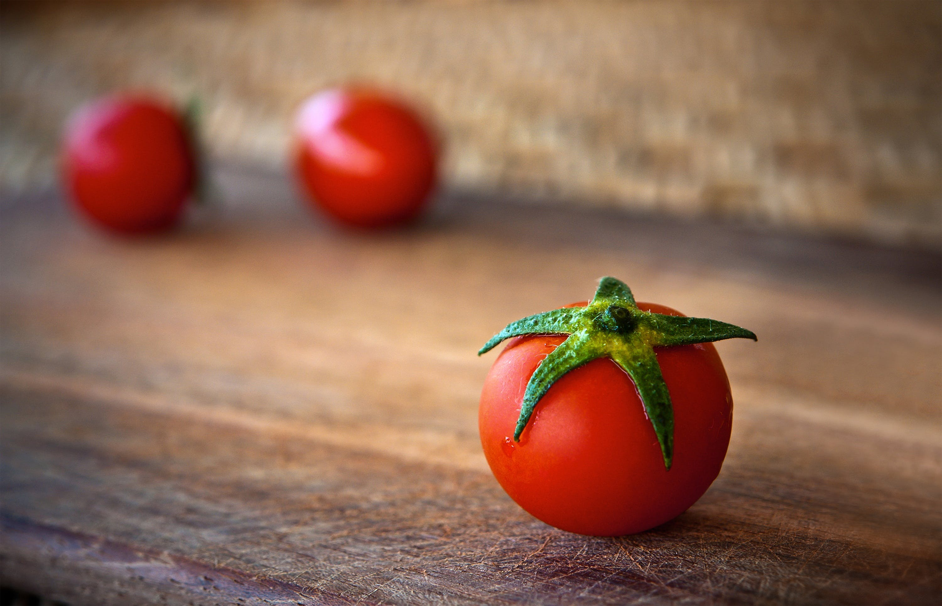 Close-up of Tomatoes on Wooden Table