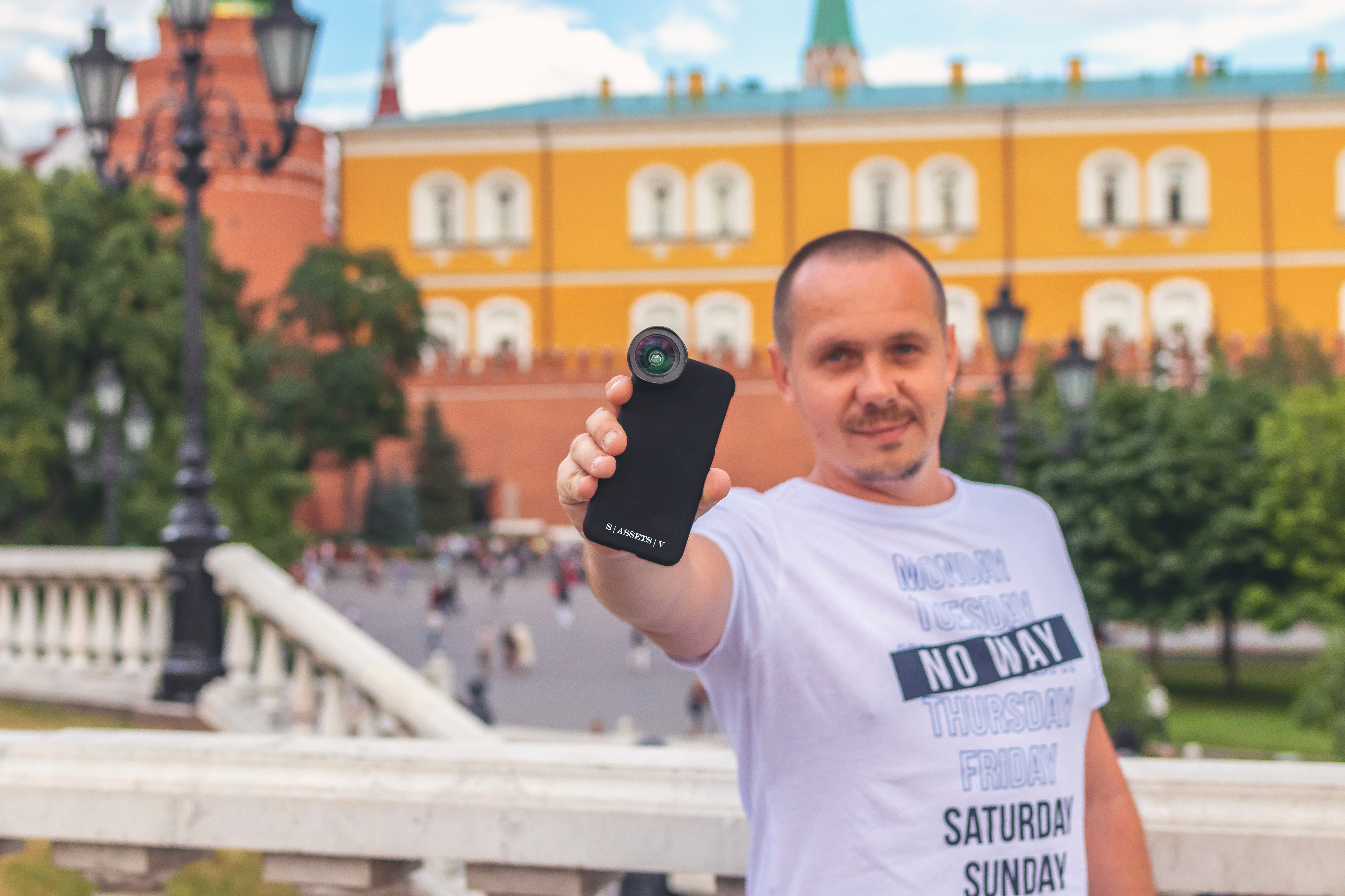 Man In White Crew Neck T-shirt Holding Phone With Lens