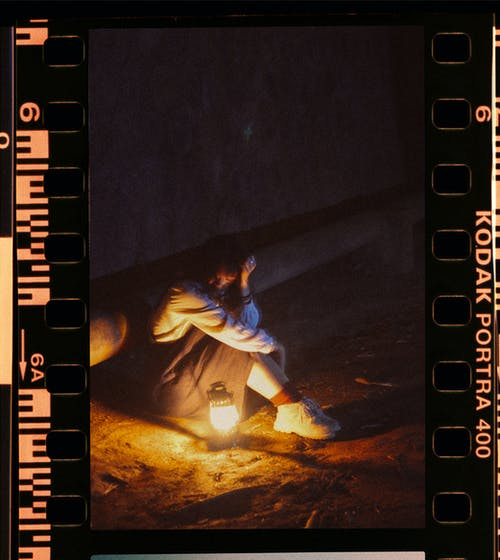 Woman Sitting On Ground At Night