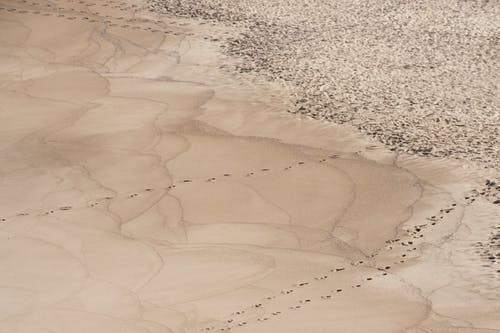 Aerial Photo of Sand With Footprints