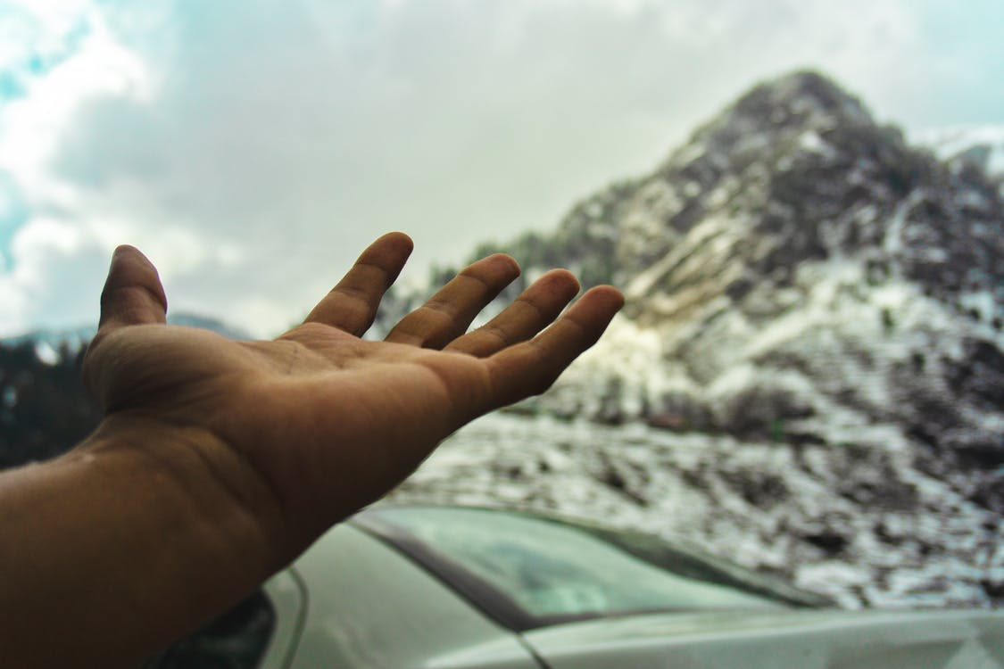 Free stock photo of hand, hand sign, mountains