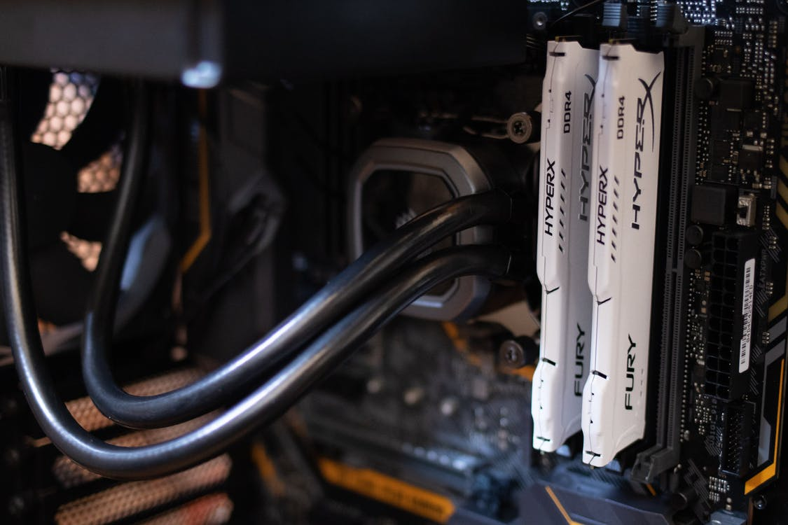 Two White Hyper X Fury Computer Dimms on Black Motherboard