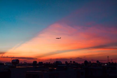Silhouette Photo of an Airplane Midair