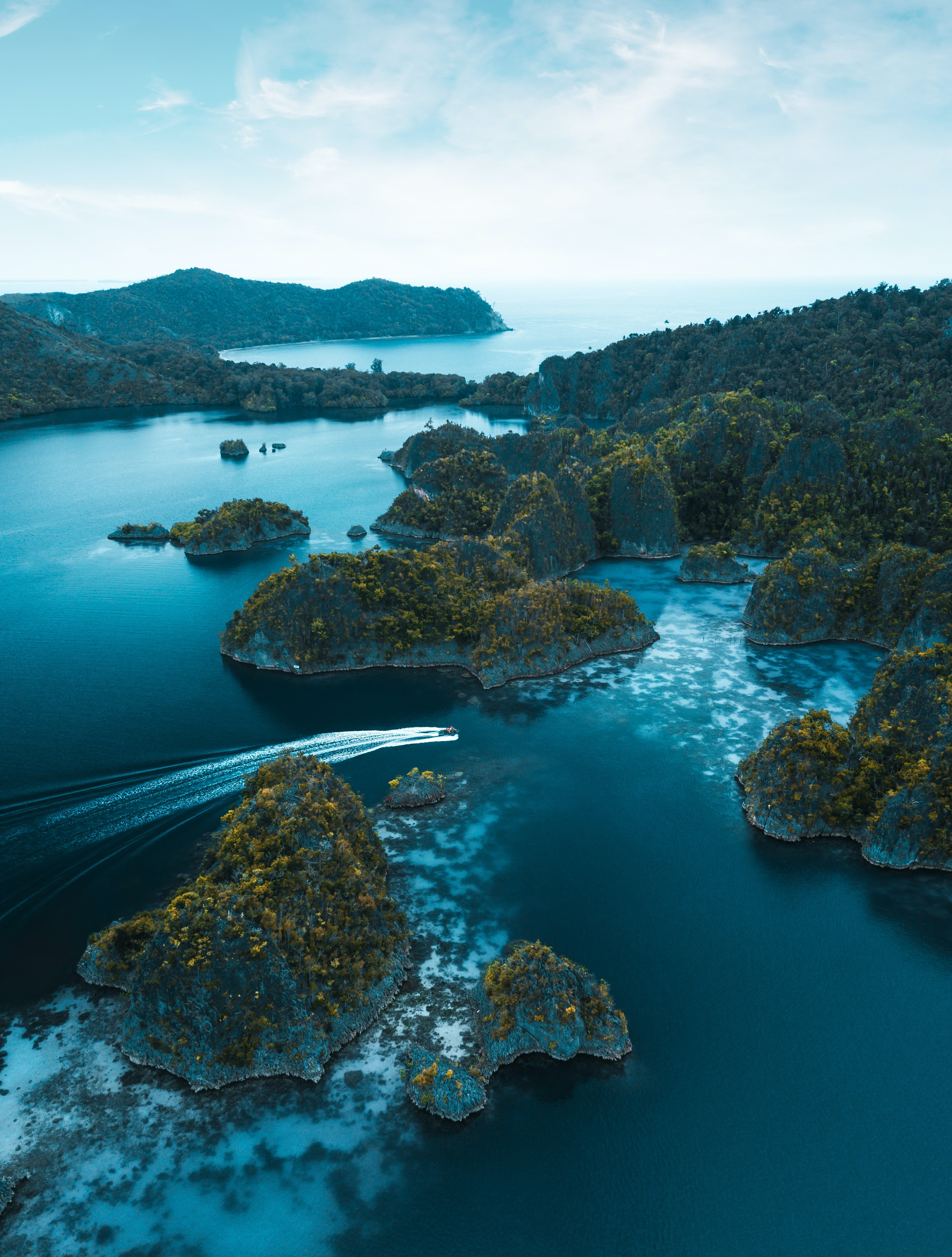 Aerial Photo of Islands on Sea by Stijn Dijkstra