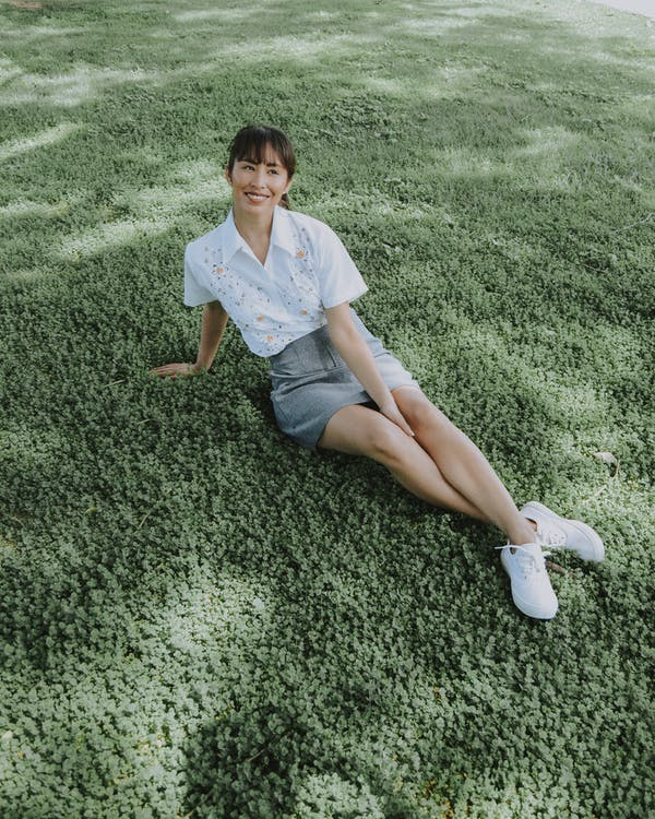 High-Angle Photo of Woman Sitting on Grass