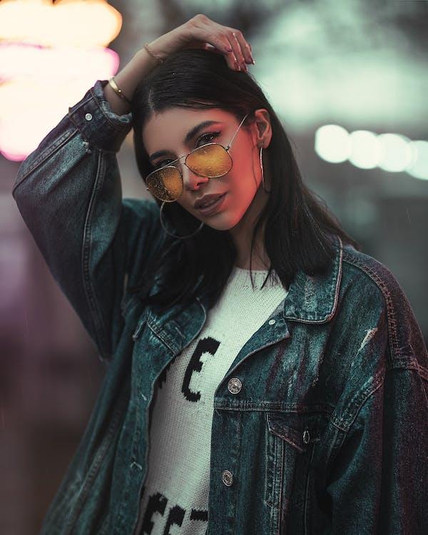 Photo of Woman in Denim Jacket