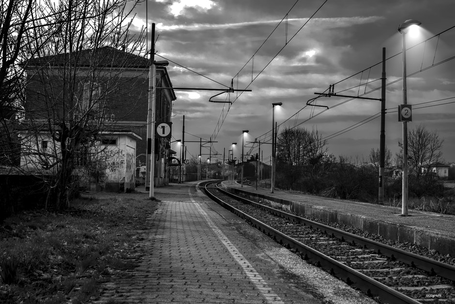 Railroad Tracks by Bare Trees Against Sky