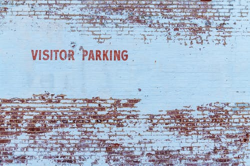 Visitor Parking Text Painted on Stonewall