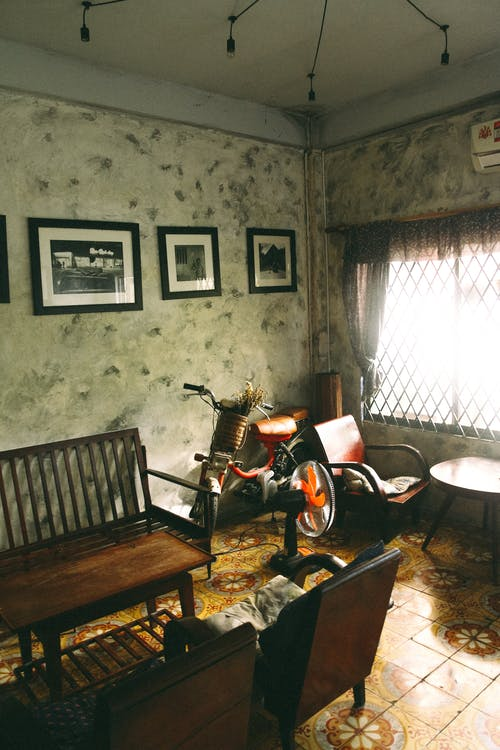 Bicycle Beside Armchair Inside Room