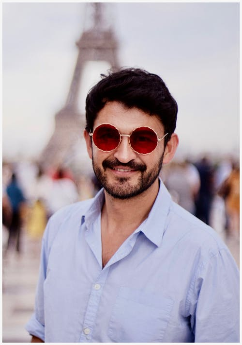 Shallow Focus Photography of Man Wearing Red Sunglasses