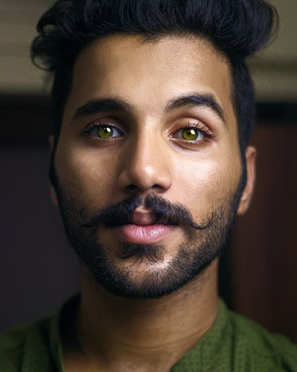 Selective Focus Portrait Photo of Man with Green Eyes Posing