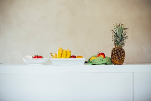 Photo of Fruits and Vegetables on White Counter