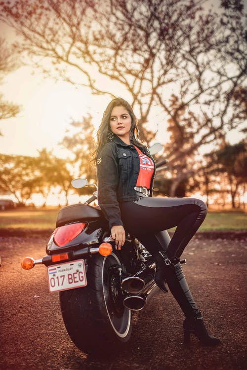 Woman Leaning On Motorcycle