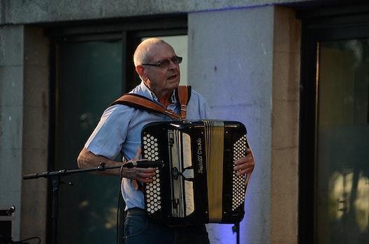 Free stock photo of city, man, musician, concert