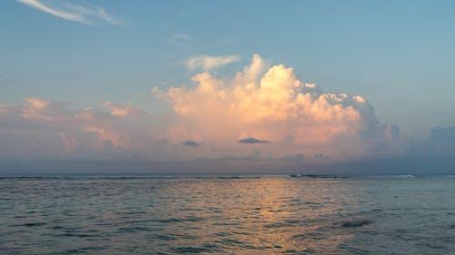 Бесплатное стоковое фото с закат, облако, океан