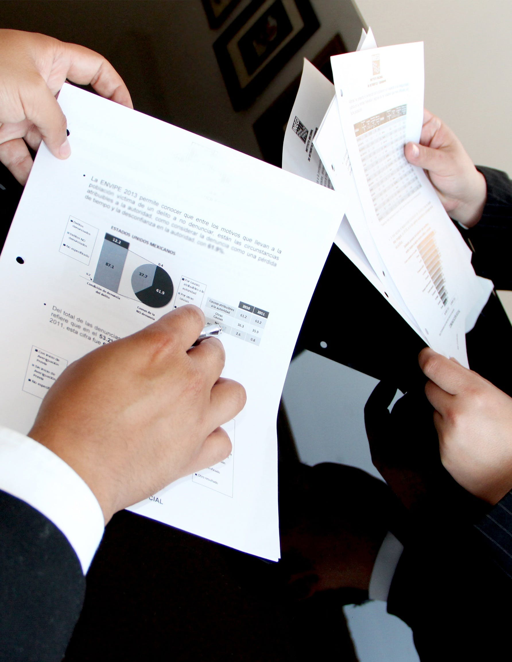 Person Holding Document Papers