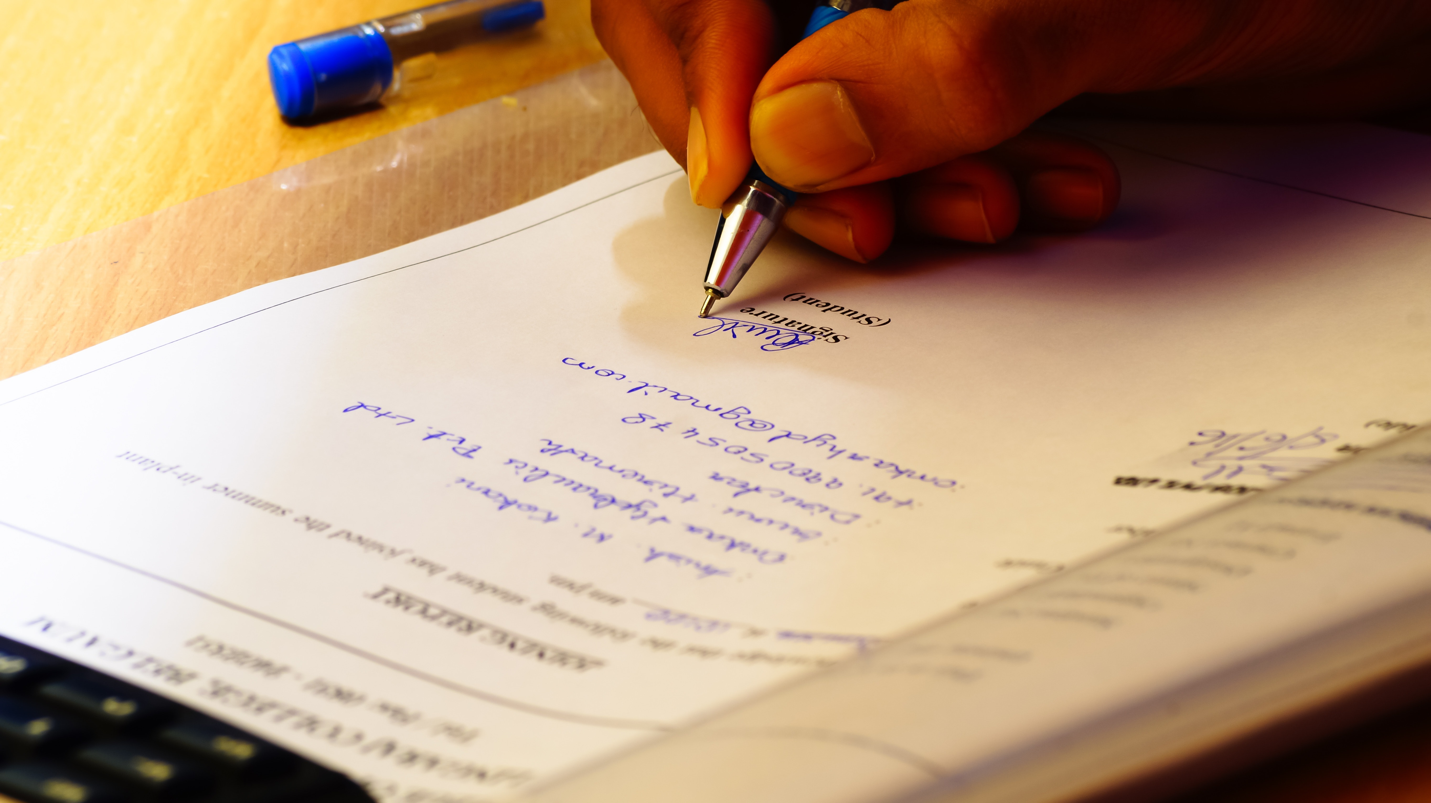 Person Signing In Documentation Paper 183 Free Stock Photo