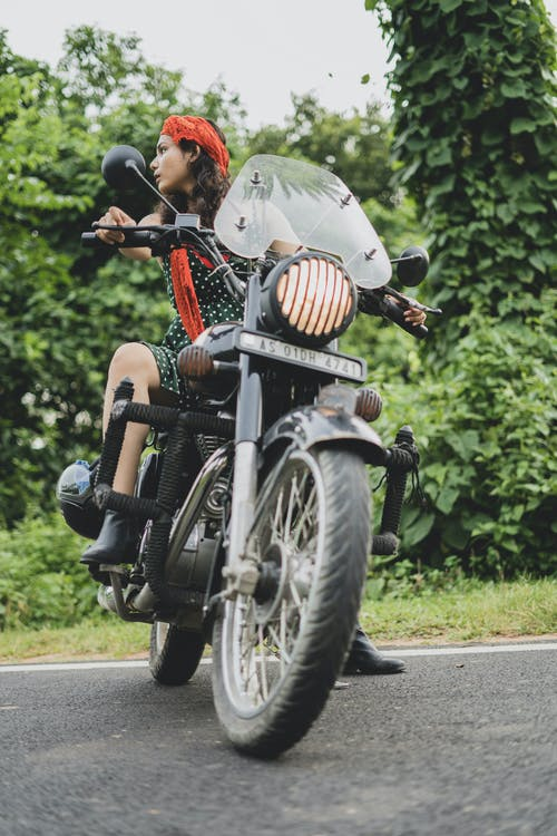 Photo of Woman Riding Motorcycle