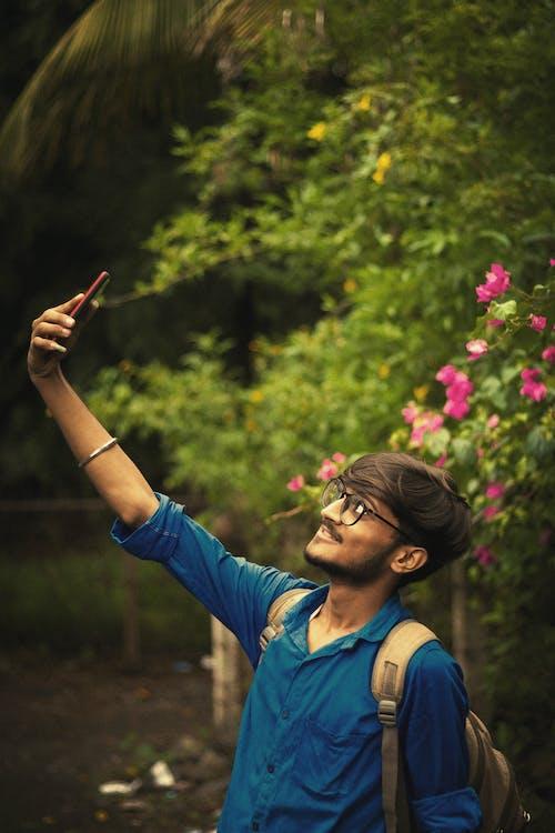Δωρεάν στοκ φωτογραφιών με 20-25 ετών, αγόρι από ινδία, αποθεματικό αγόρι, αυτοπροσωπογραφία
