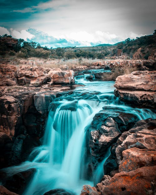Безкоштовне стокове фото на тему «вода, водний потік, Водоспад, дика місцевість»