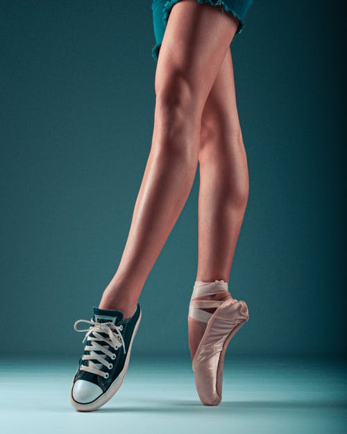 Photo of Person Wearing Sneaker and Ballet Shoe