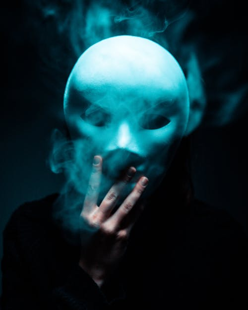 Photo of Person Holding White Mask