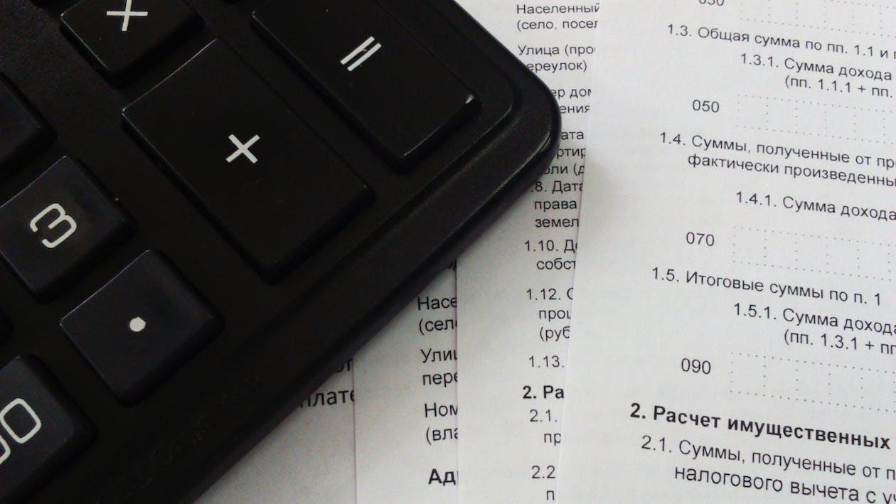 Black Calculator on White Printer Paper