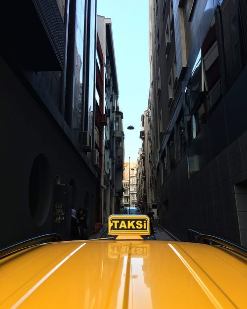 Photo of Yellow Taxi on Narrow Street