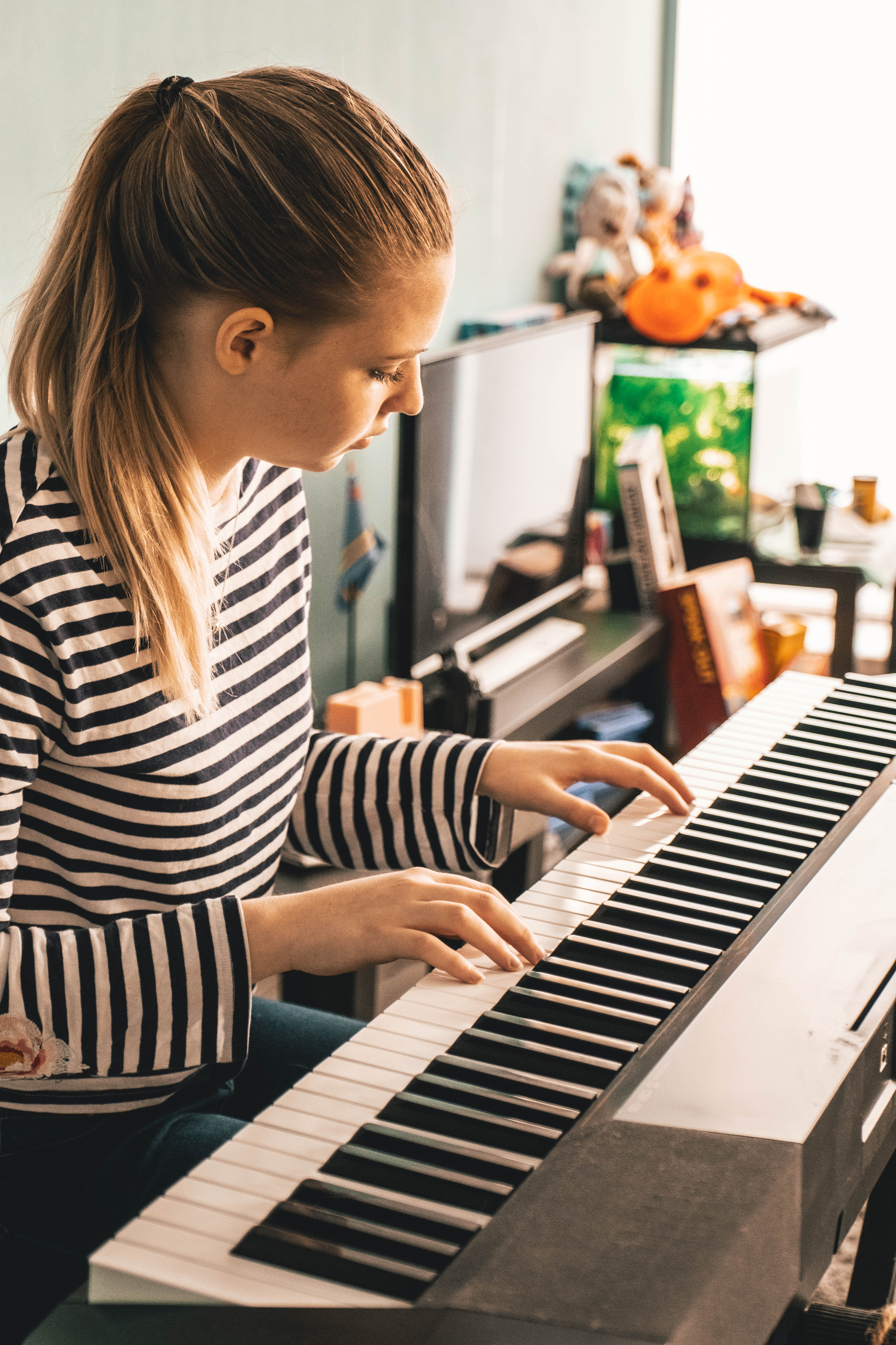 Photo Of Woman Playing Piano Free Stock Photo