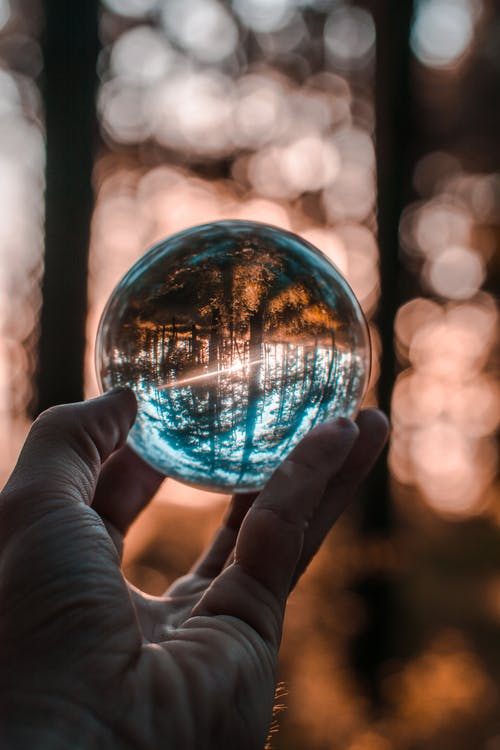 Close-Up Photo of Person Holding Crystal Ball