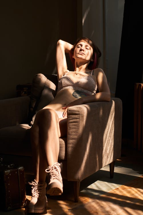 Photo of Woman Sitting on Chair