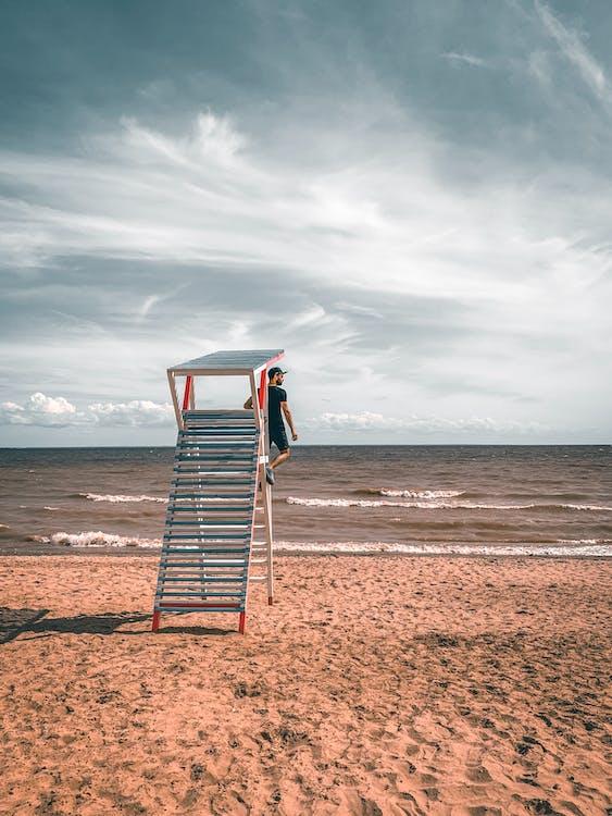 Photo OF Man Near Ocean