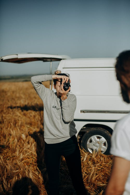 Photo of a Woman Taking Photo of Man