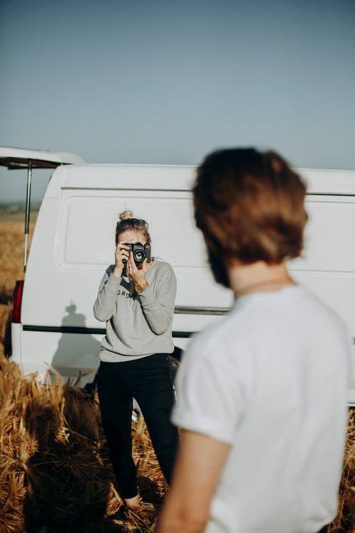 Photo of a Woman Taking a Man's Photo