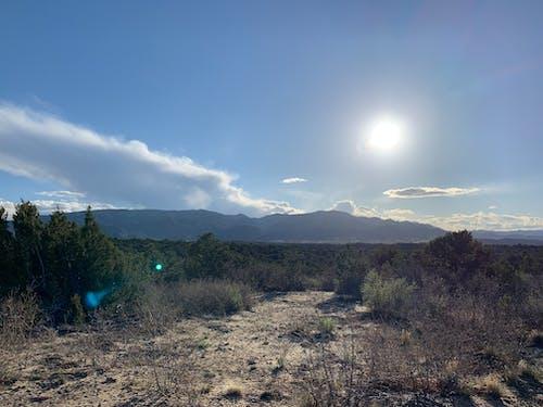 Foto d'estoc gratuïta de cel, clons, lent fl, muntanyes