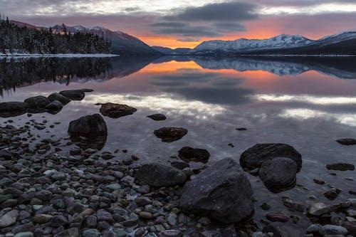 açık hava, akşam karanlığı, dağ, glacier milli parkı içeren Ücretsiz stok fotoğraf