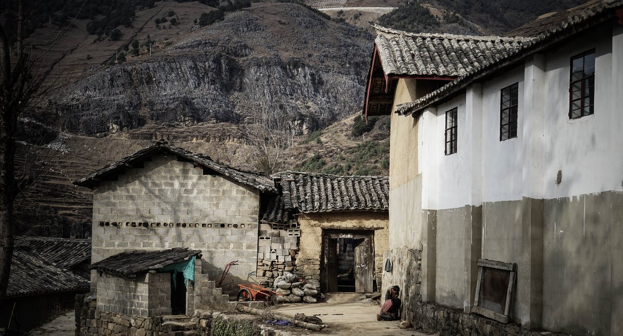 Village Near Mountain Cliff