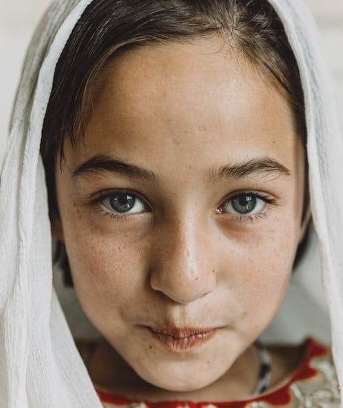 Close-Up Photo of Girl Wearing White Headscarf