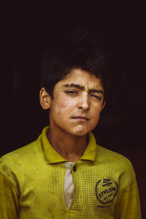 Portrait Photo of Boy in Yellow Polo Shirt