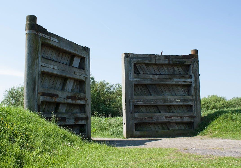 Gray Wooden Gate Between Grass