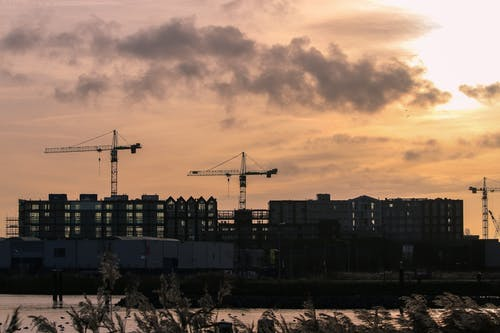 Three Cranes Near Intermodal Containers