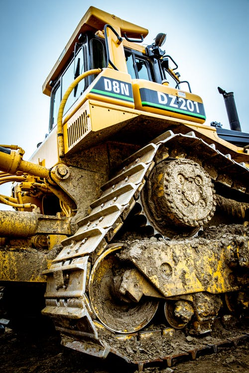 Low-angle Photography of Yellow D8n Dz201 Heavy Equipment