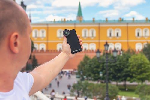 คลังภาพถ่ายฟรี ของ การถ่ายภาพ, ผู้ชาย, มือถือ, สมาร์ทโฟน