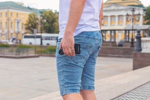 Man Wearing Blue Denim Shorts