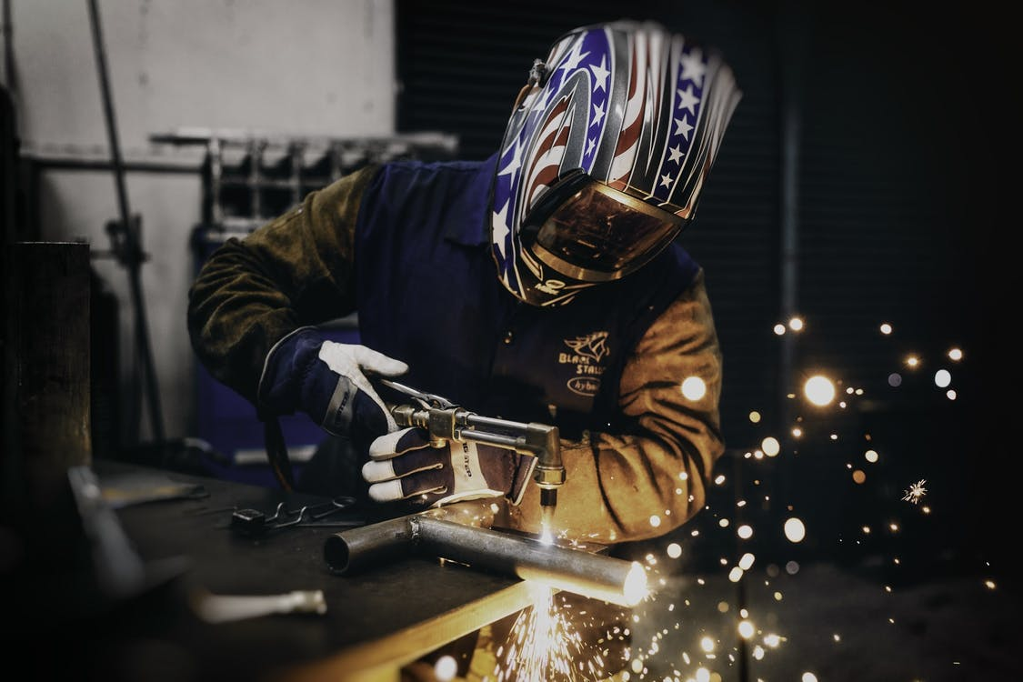 Man Welding Bar